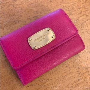 Pink Michael Kors leather wallet